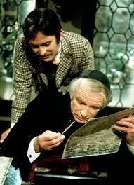 Bassanio et Shylock , qui consulte le taux d'usure fixé par la bourse.